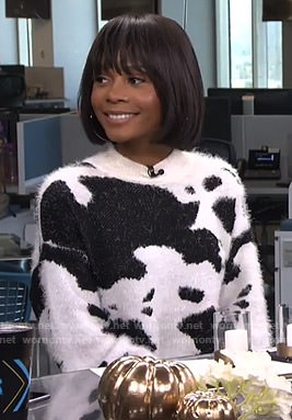 Zuri's cow print fluffy sweater on Live from E!