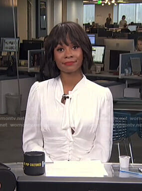 Zuri's white tie neck blouse on Live from E!