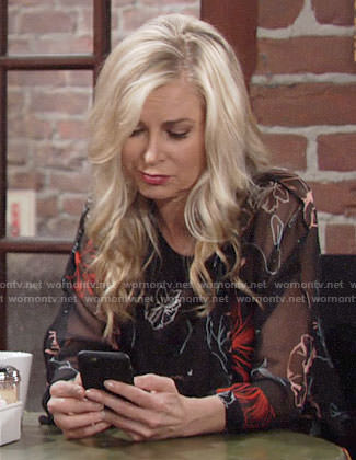 Ashley's black floral blouse on The Young and the Restless