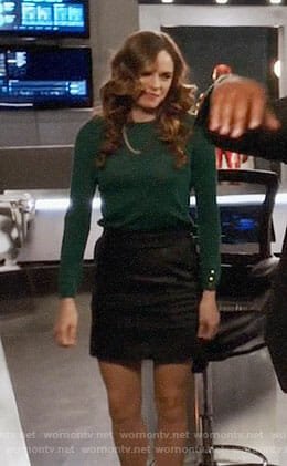 Caitlin's green button cuff sweater and leather skirt on The Flash