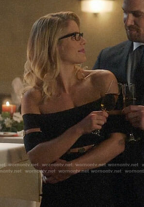 Felicity's black off-shoulder dress with metal discs on Supergirl