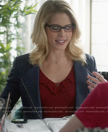 Felicity's red ruffled top and blue leather jacket on Supergirl