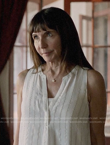 Gail's white metallic stripe top on Last Man on Earth