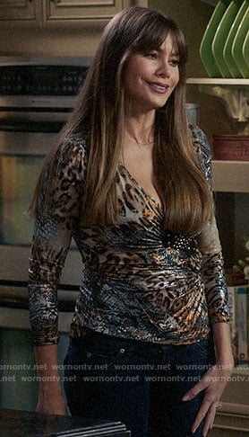 Gloria's metallic leopard print top on Modern Famly