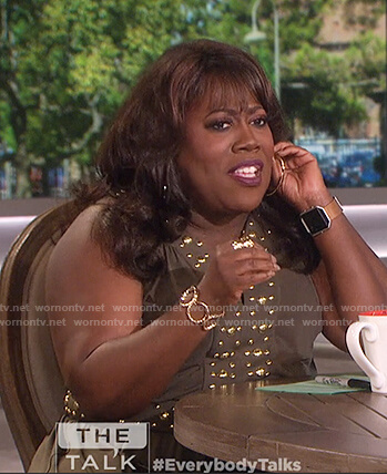 Sheryl's green gold studded dress on The Talk