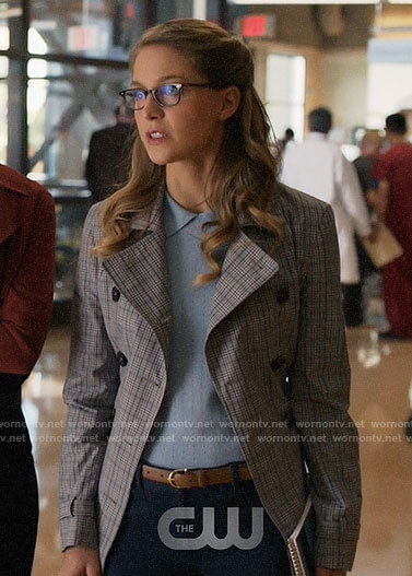 Kara's blue collared top and plaid trench coat on Supergirl