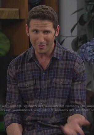 Josh's blue plaid shirt on 9JKL