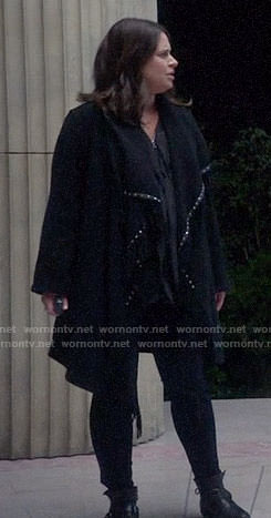 Quinn's black studded trim coat on Scandal
