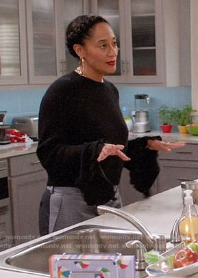 Rainbow's black ruffle trim sweater and colorblock trousers on Black-ish