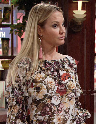 Sharon's floral ruffled blouse and pink tassel earrings on The Young and the Restless