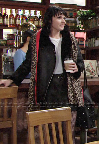 Tessa's black fleece trim moto jacket and leopard print scarf on The Young and the Restless