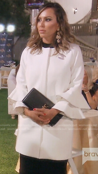Kelly's white bell sleeve coat on The Real Housewives of OC