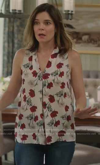 Heather's white floral print sleeveless top on Life in Pieces