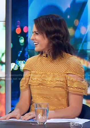 Rachel's yellow lace ruffle front dress on The Project