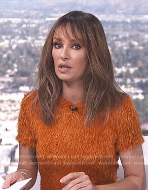 Catt's orange fluffy short sleeve top on E! News Daily Top