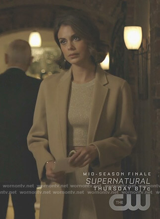 Cristal's gold cropped top and skirt on Dynasty