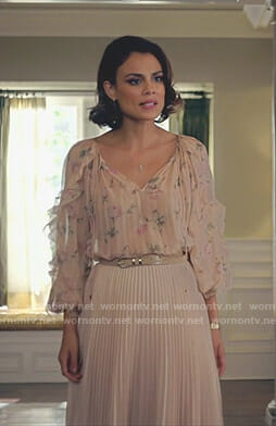 Cristal's pink floral ruffle sleeve blouse and pleated skirt on Dynasty
