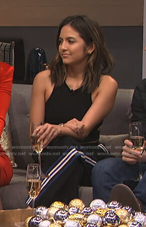 Erin's black side striped pants on E! News
