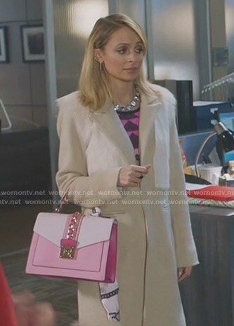 Portia's beige fur panel coat and pink hand bag on Great News