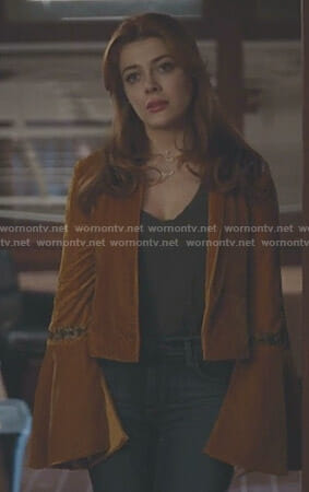 Sonia's orange velvet bell sleeve jacket on The Gifted