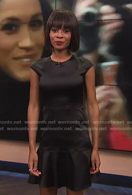 Zuri's black satin flare dress on E! News