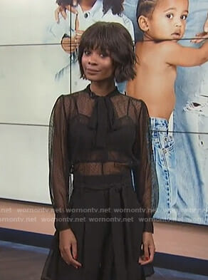 Zuri's black tie neck mesh blouse on E! News