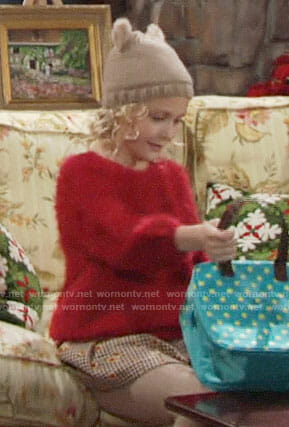 Faith's red fluffy sweater and checked skirt on The Young and the Restless
