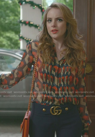 Fallon's printed blouse and blue cropped pants on Dynasty