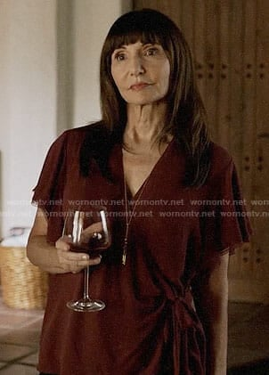 Gail's burgundy wrap top on The Last Man on Earth