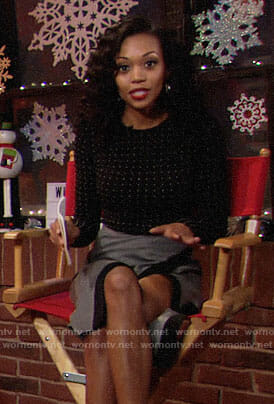 Hilary's black dotted top and grey skirt on The Young and the Restless