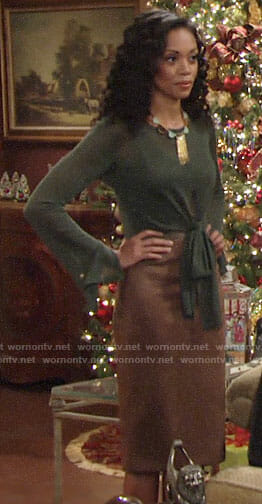 Hilary's green tie-front top and brown suede skirt on The Young and the Restless