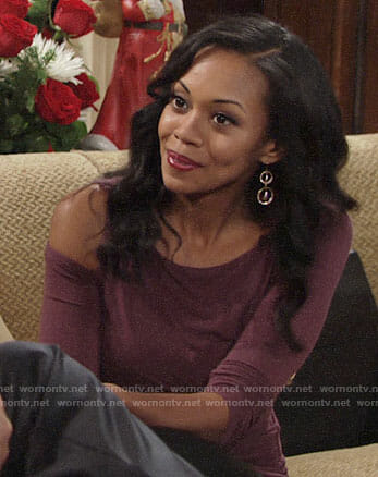 Hilary's purple top with cutout shoulder on The Young and the Restless