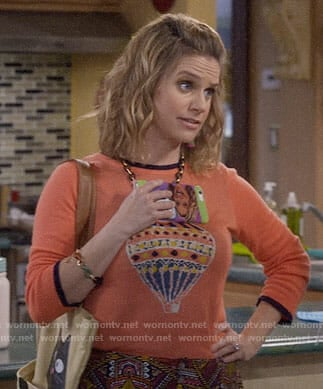 Kimmy's orange hot air balloon sweater on Fuller House