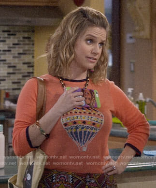 Kimmy's orange hot air balloon sweater on Fuller House