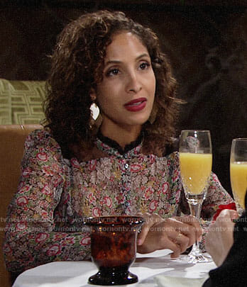 Lily's floral top with lace shoulders on The Young and the Restless