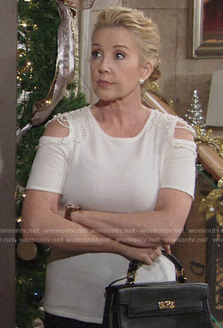 Nikki's white pearl embellished cold-shoulder top on The Young and the Restless