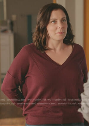 Rebecca's red v-neck sweater on Crazy Ex-Girlfriend