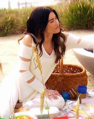Steffy's white sweater with cutout sleeves on The Bold and the Beautiful