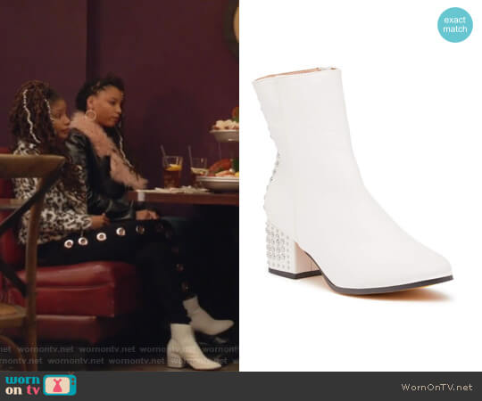 Maura Studded Snake Skin Print Boots by Chase and Chloe worn by Skylar Forster (Halle Bailey) on Grown-ish