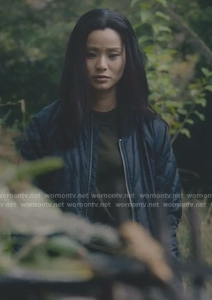 Clarice's navy quilted bomber jacket on The Gifted