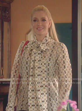 Erika's logo print tie neck blouse on The Real Housewives of Beverly Hills