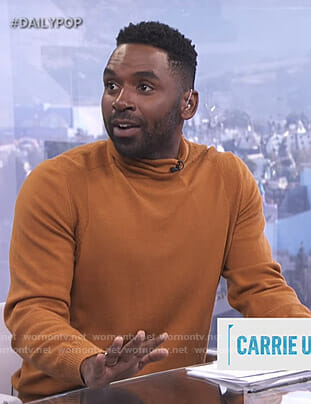 Justin's orange turtleneck sweater on E! News Daily Pop