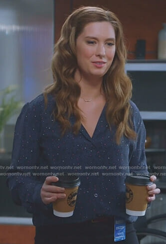 Katie's navy printed shirt on Great News