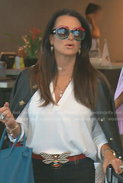Kyle's black jacket with tiger head buttons and bee buckle belt on The Real Housewives of Beverly Hills