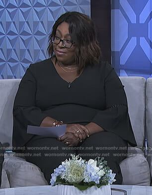 Loni's black bell sleeve jumpsuit on The Real