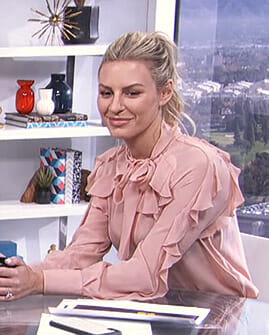Morgan's pink ruffled tie neck blouse on E! News Daily Pop