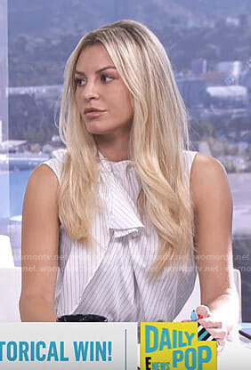 Morgan's white pinstripe sleeveless top on E! News Daily Pop