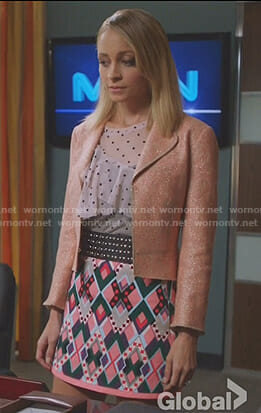 Portia's white dotted ruffled top and pink printed mini skirt on Great News