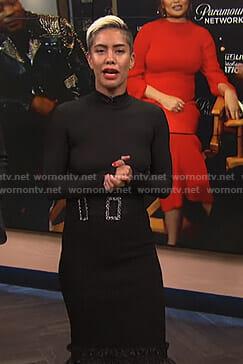 Sibley's black ruffle hem skirt and crystal buckle belt on E! News