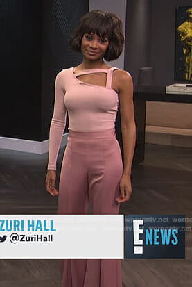 Zuri's pink one shoulder cutout top and wide-leg pants on E! News